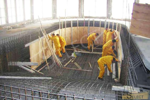 Filling and reinforcement of the pool bowl