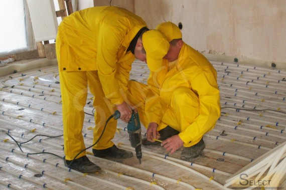 Installation of floor heating in a country house on the second floor
