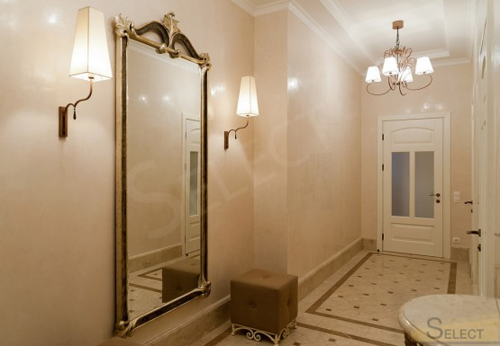 Photo of an ordinary corridor in an apartment in an exquisite classic style