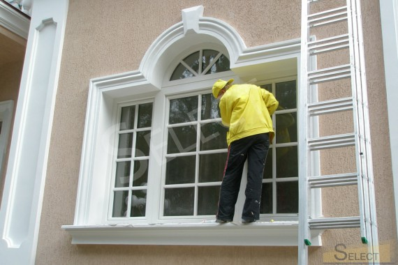 Construction work in the villa. Facade decoration. Window