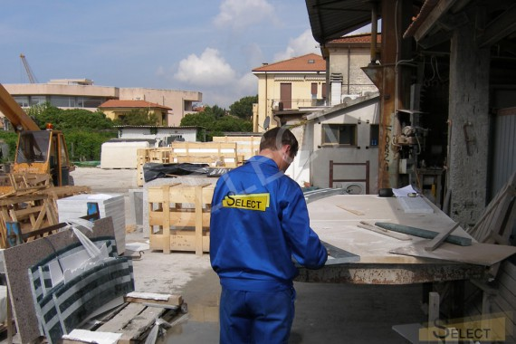 Quality control of production of tiles from natural marble in Italy