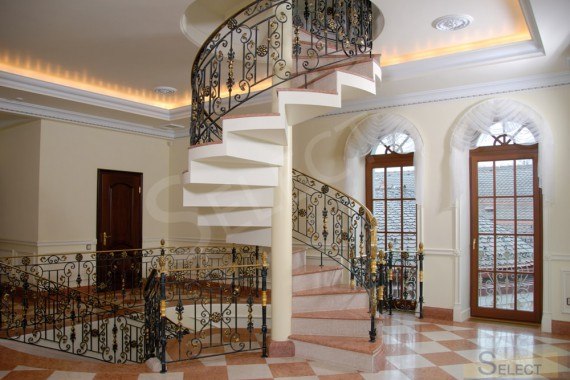 Photo of a wrought-iron spiral staircase - Robers in the gallery at the villa